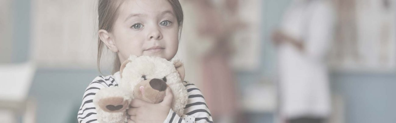 Young child holding teddy bear