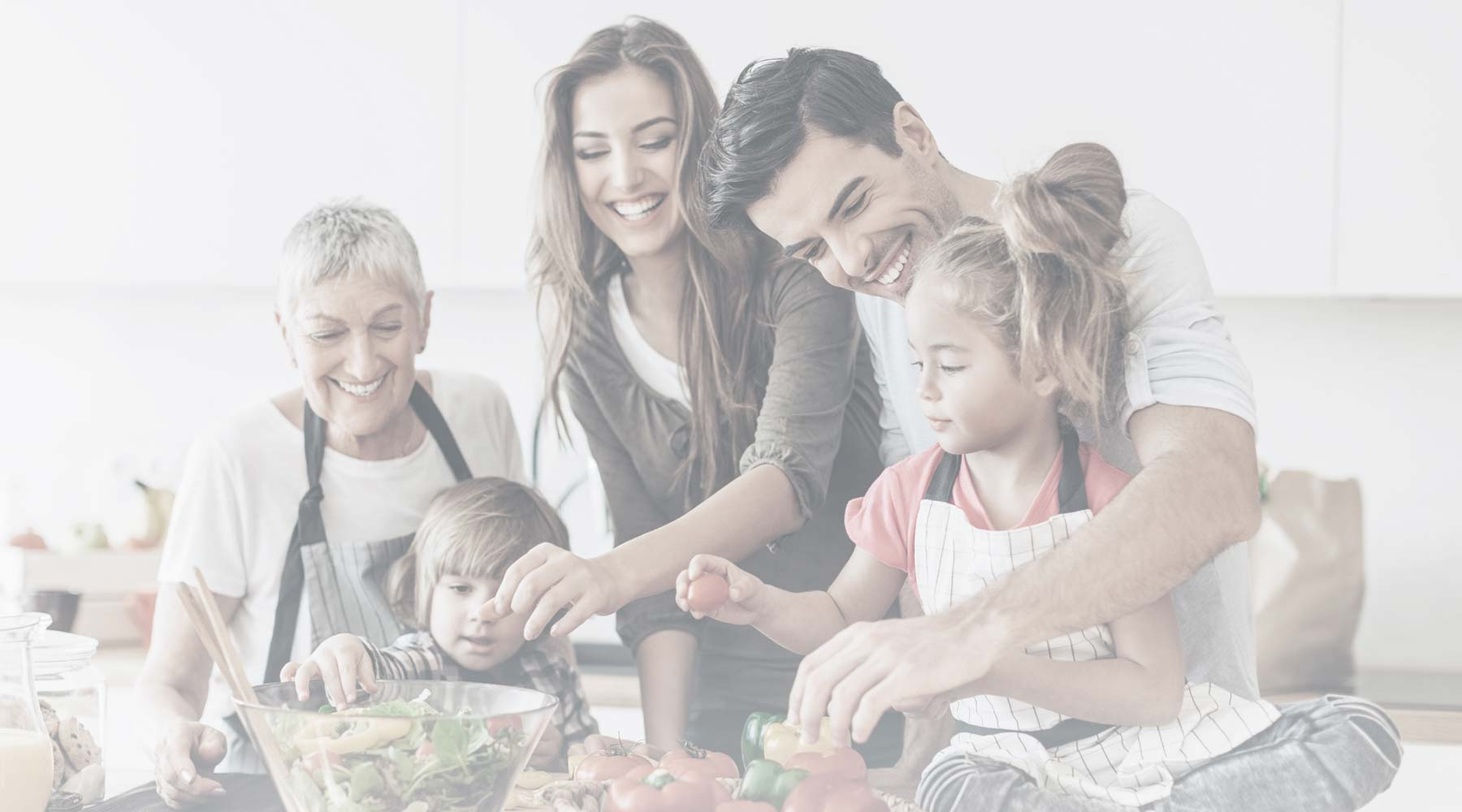 Family cooking healthy meal together
